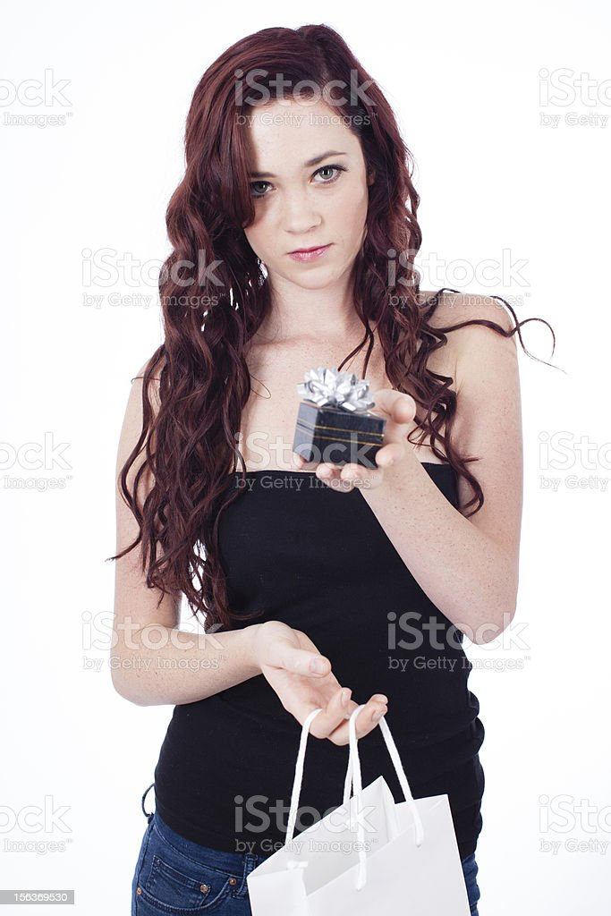 Beautiful Woman offering a gift royalty-free stock photo