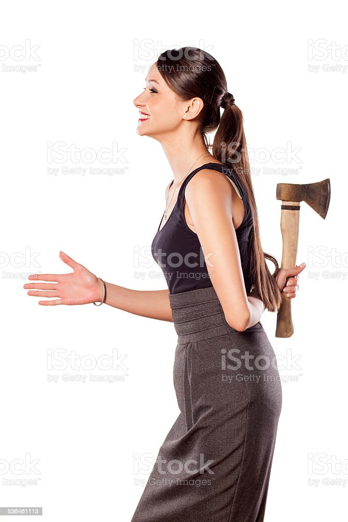 Beautiful woman offering hand with an ax behind her back stock photo