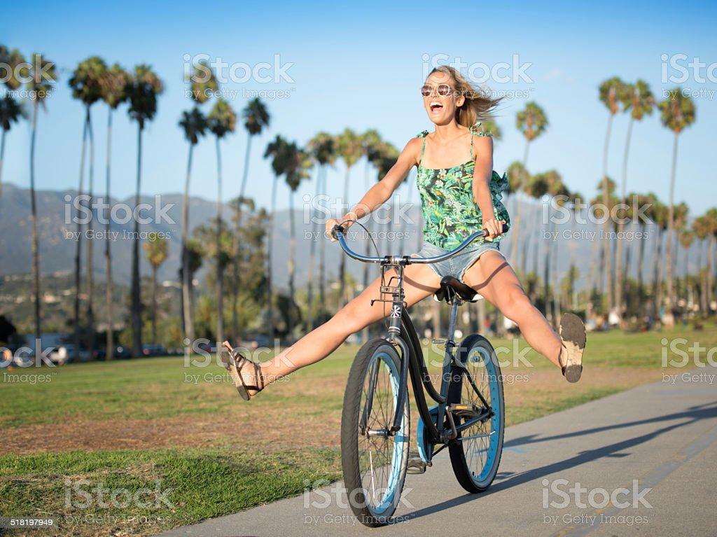 Beautiful Woman on a Bicycle, Candid Fun stock photo