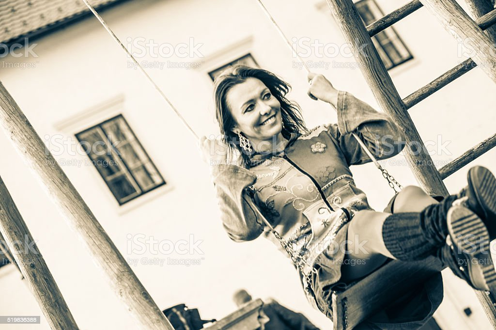 Beautiful Woman on a Swing stock photo