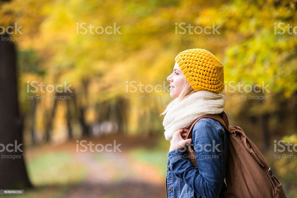 Beautiful woman on a walk in autumn forest stock photo