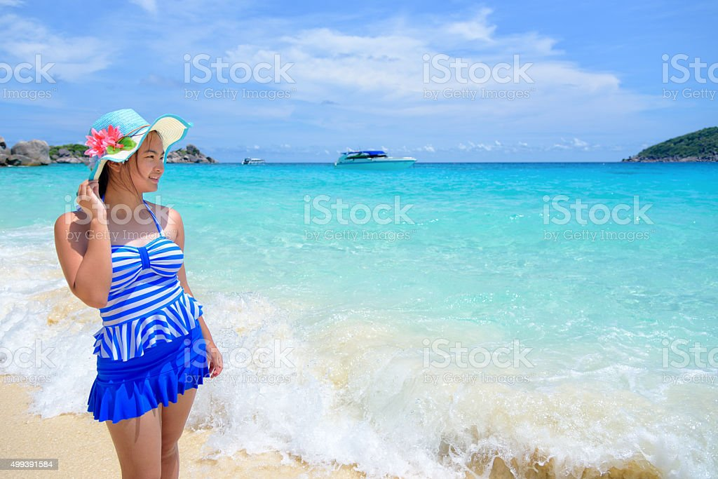 Beautiful woman on beach in Thailand stock photo