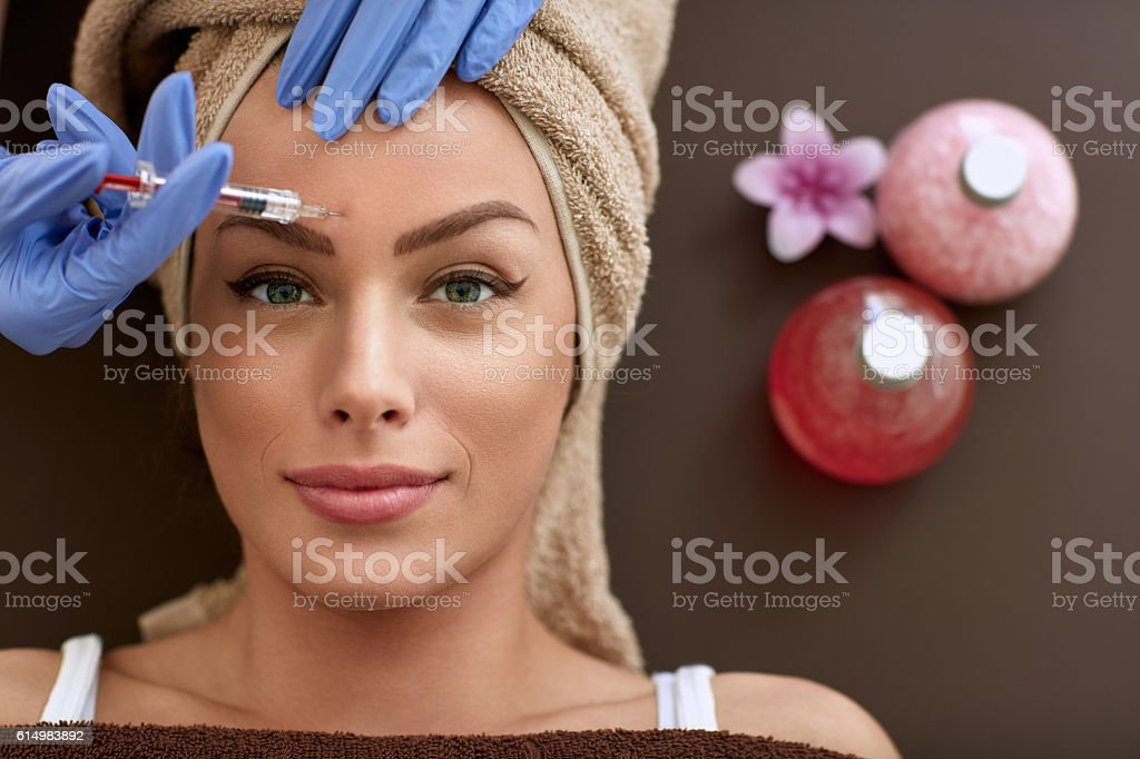 Beautiful woman on  correction of wrinkles stock photo