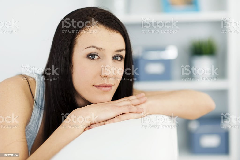 Beautiful woman on couch royalty-free stock photo