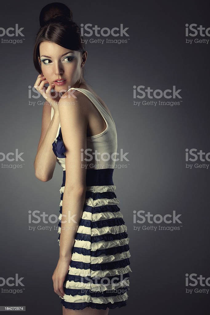 Beautiful woman on dark background royalty-free stock photo