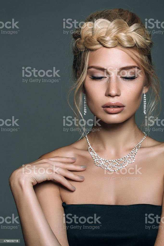 Beautiful woman on dark background stock photo