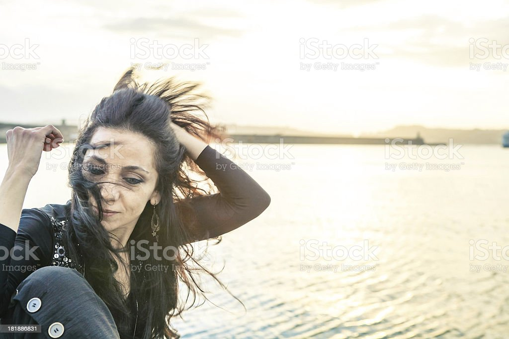 Beautiful Woman on Harbor in Winter royalty-free stock photo