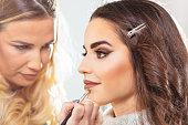 Beautiful woman on make up session