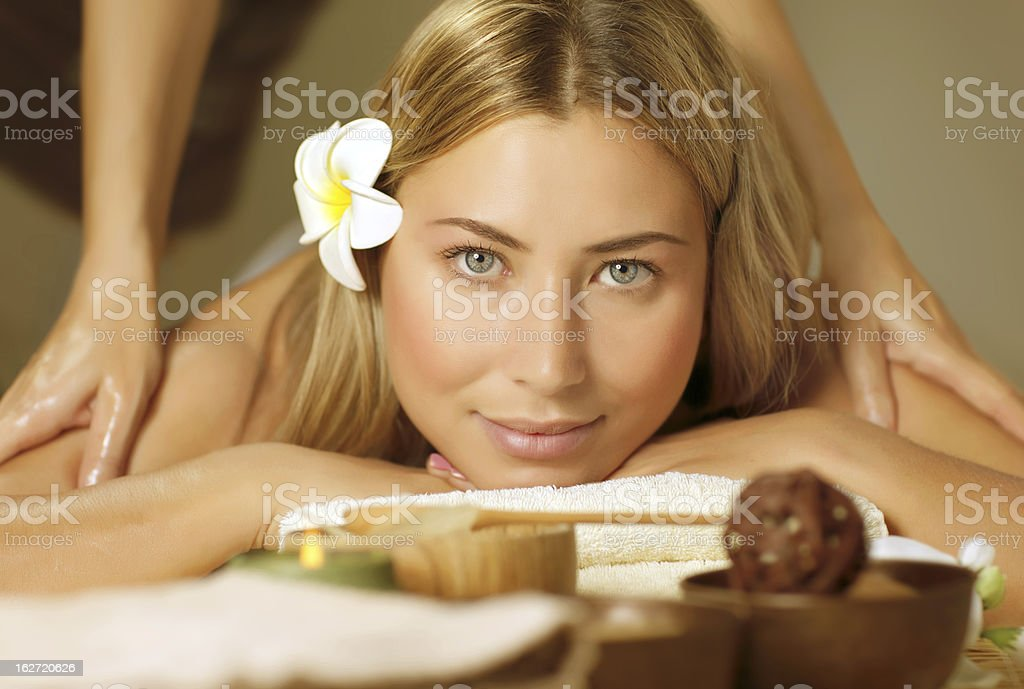 Beautiful woman on massage table royalty-free stock photo