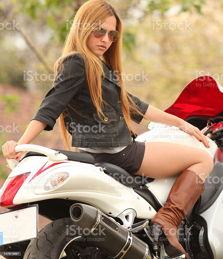 Beautiful woman on motorcycle royalty-free stock photo