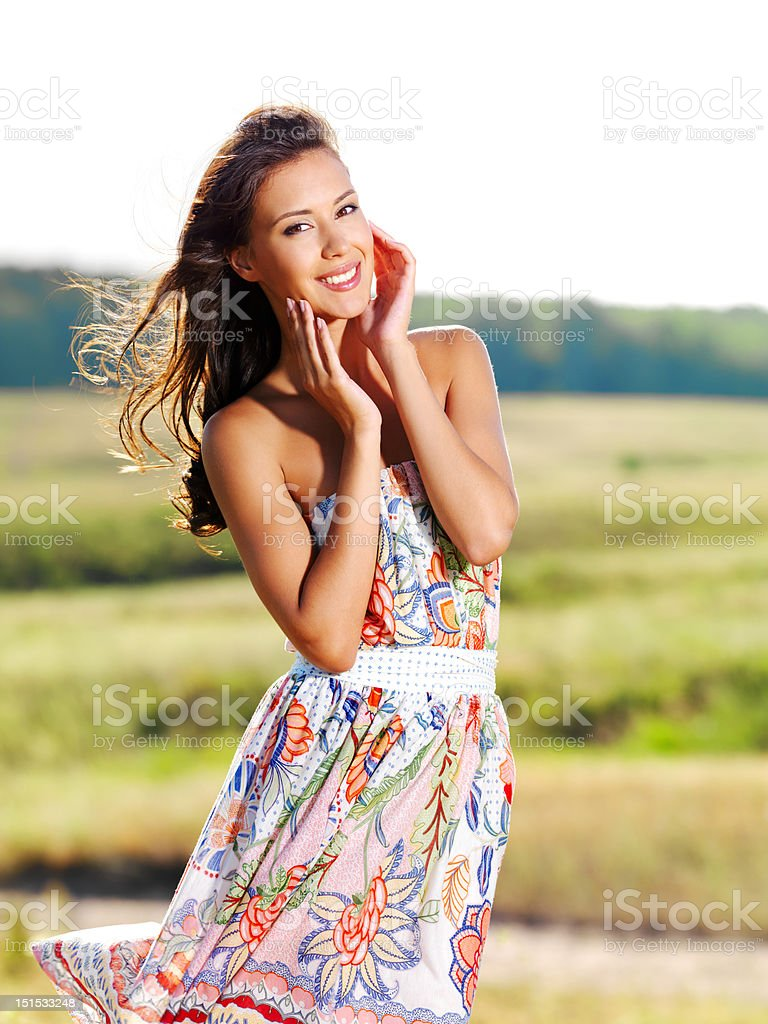 beautiful woman on nature in black sunglasses royalty-free stock photo