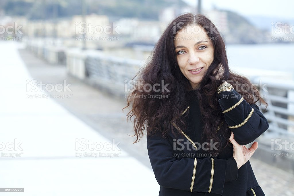 Beautiful Woman on Pier in Winter royalty-free stock photo