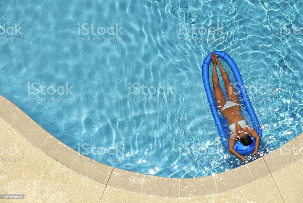Beautiful Woman on Raft in a Pool royalty-free stock photo