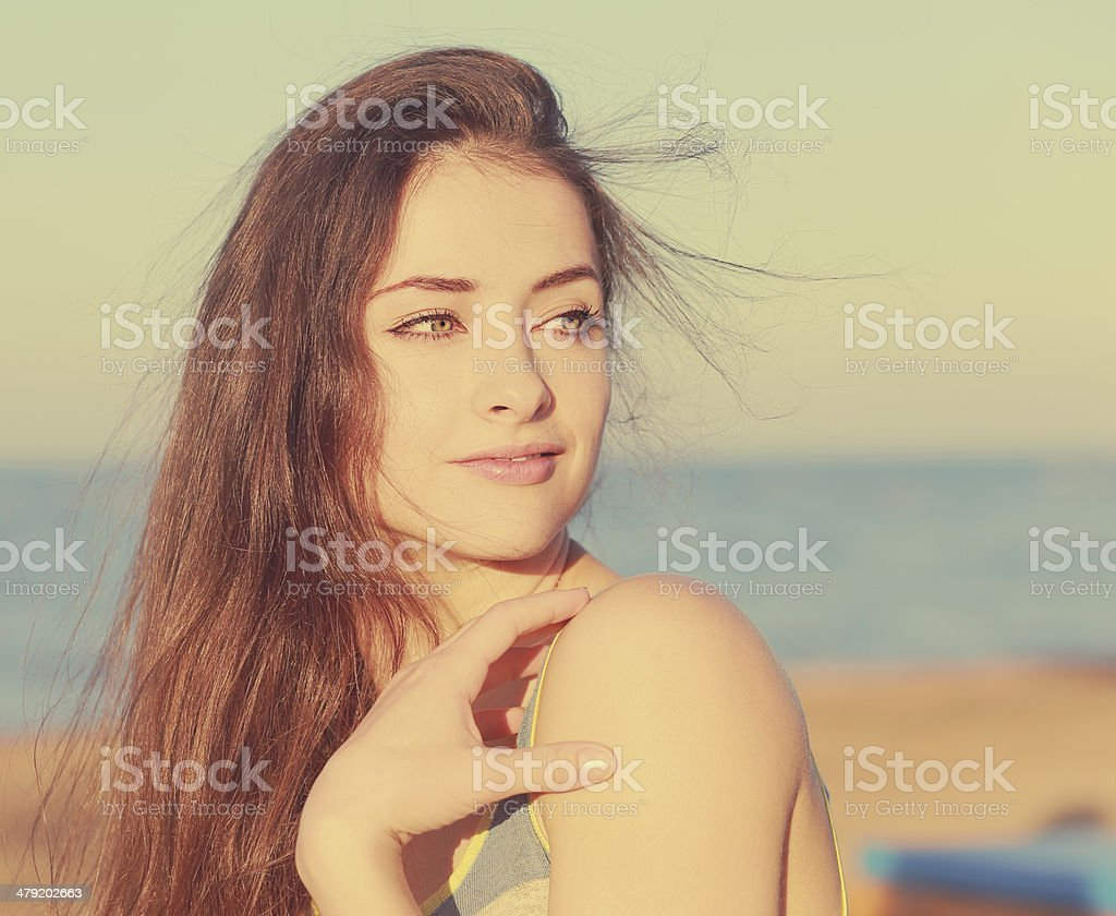Beautiful woman on sea background. stock photo