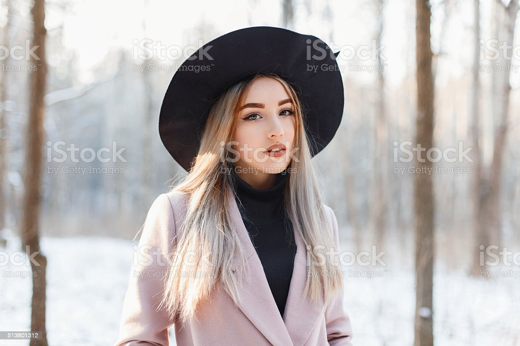 Beautiful woman on the background of a winter forest stock photo