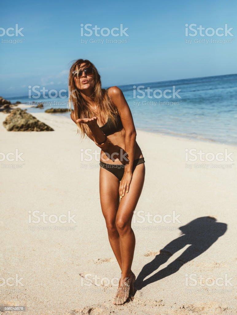 Beautiful woman on the beach vacation having fun stock photo