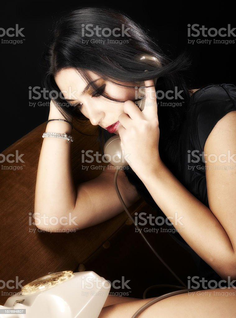 Beautiful Woman On The Old Phone. Color Image stock photo