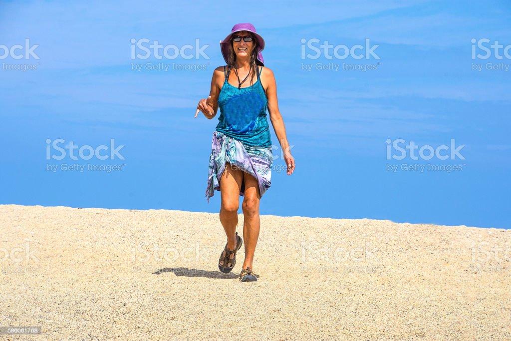 Beautiful woman on white sand stock photo