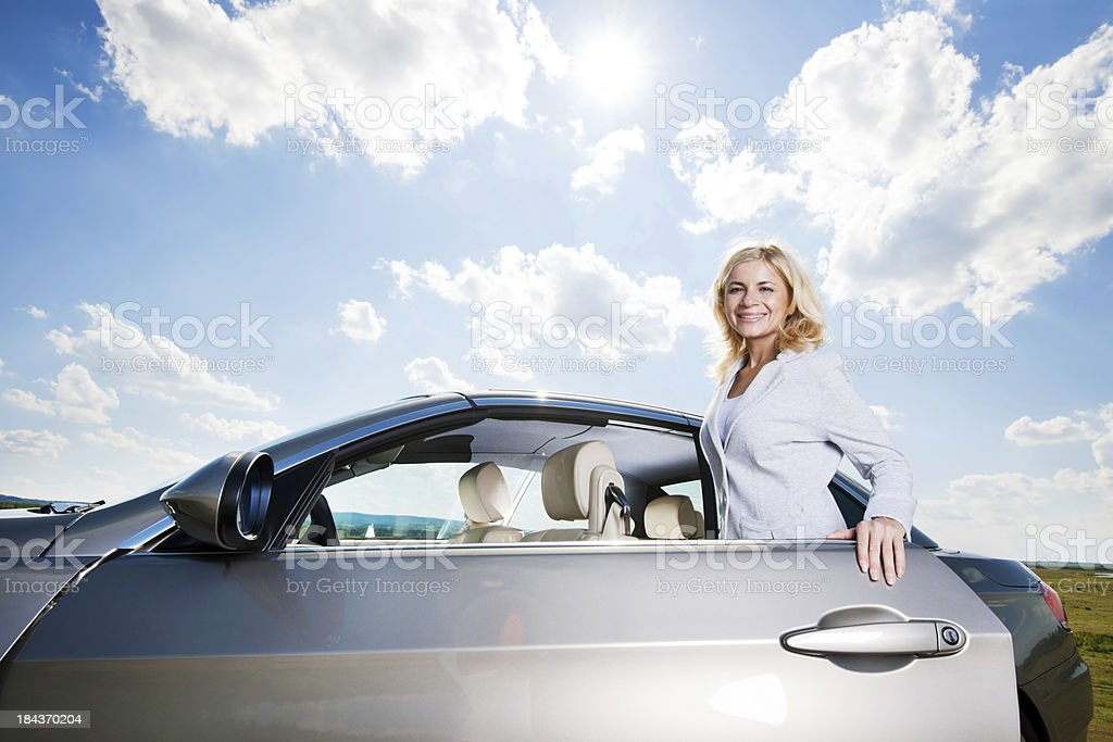 Beautiful woman opening her car door. royalty-free stock photo