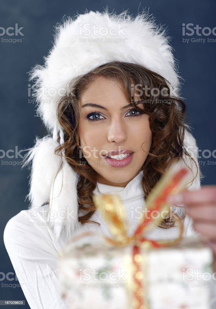 Beautiful woman opening her gift royalty-free stock photo