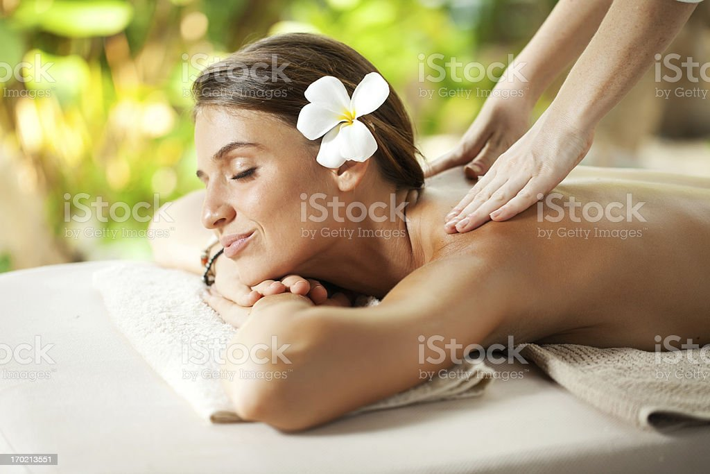 Beautiful woman outdoor receiving a back massage. royalty-free stock photo