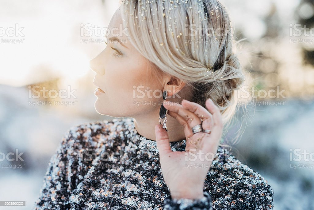Beautiful woman outdoors in winter stock photo