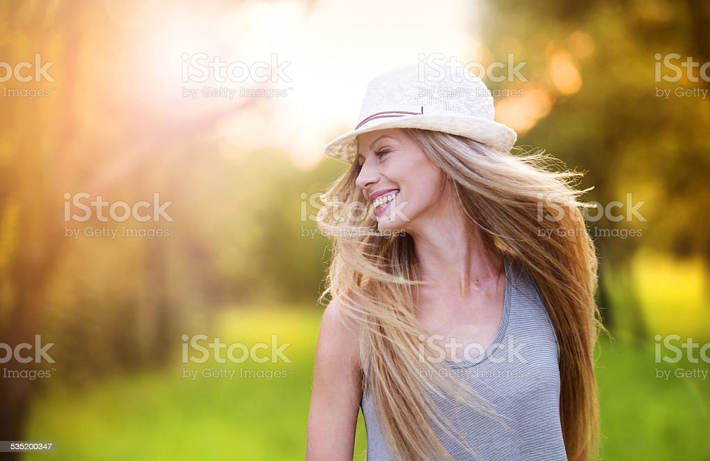 Beautiful woman outside in a park. stock photo
