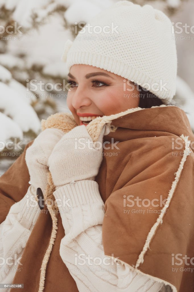 Beautiful woman outside in winter time, looking forward stock photo