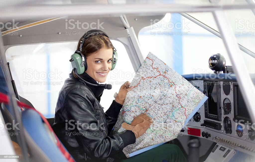 Beautiful woman pilot in a airplane. stock photo