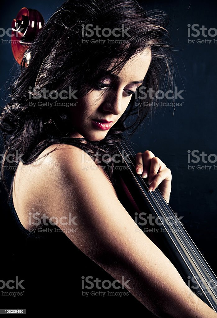 Beautiful woman playing double bass royalty-free stock photo