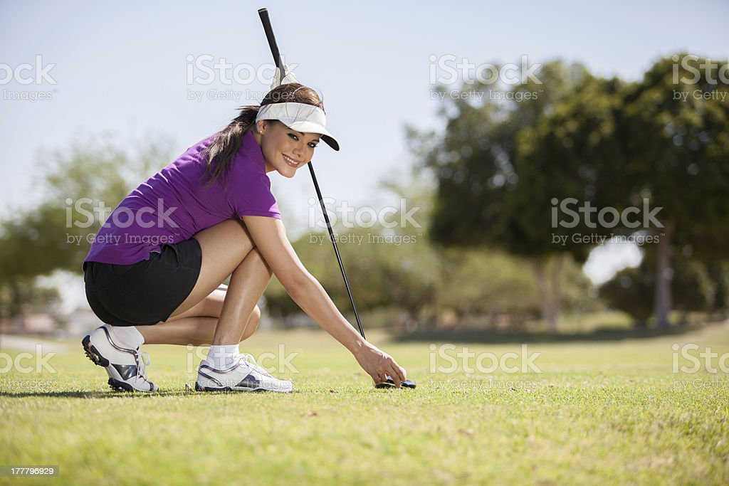 Beautiful woman playing golf royalty-free stock photo