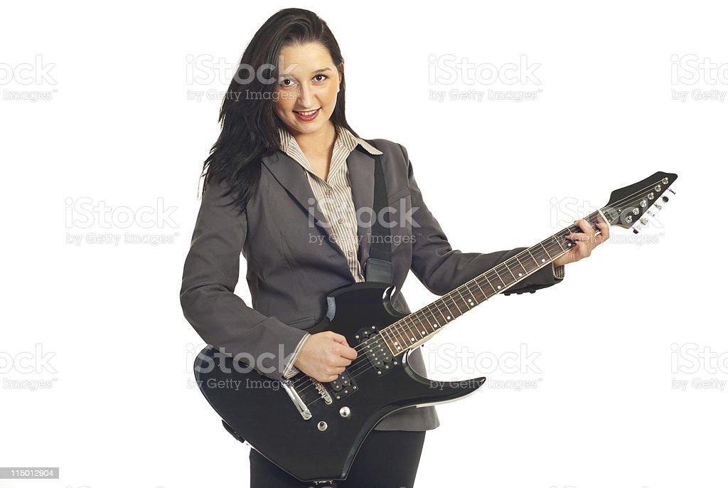 Beautiful woman playing guitar stock photo