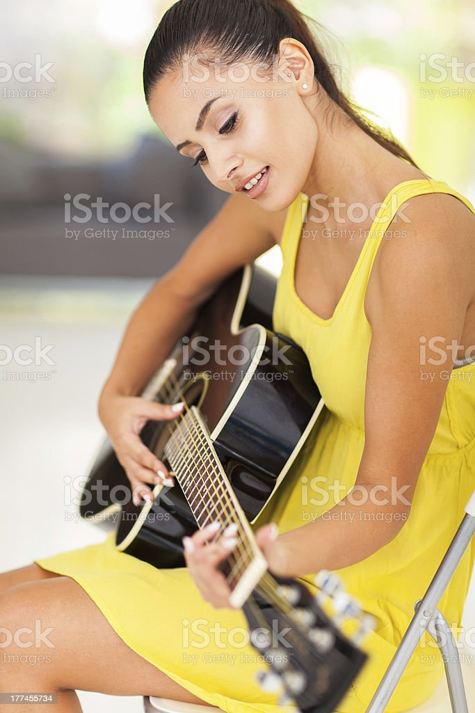 beautiful woman playing guitar royalty-free stock photo