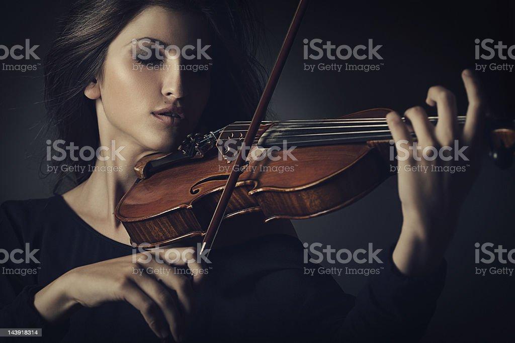 Beautiful woman playing on the violin stock photo
