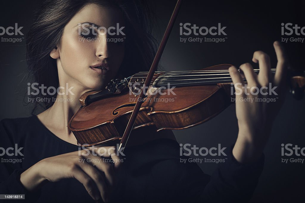 Beautiful woman playing on the violin stock photo