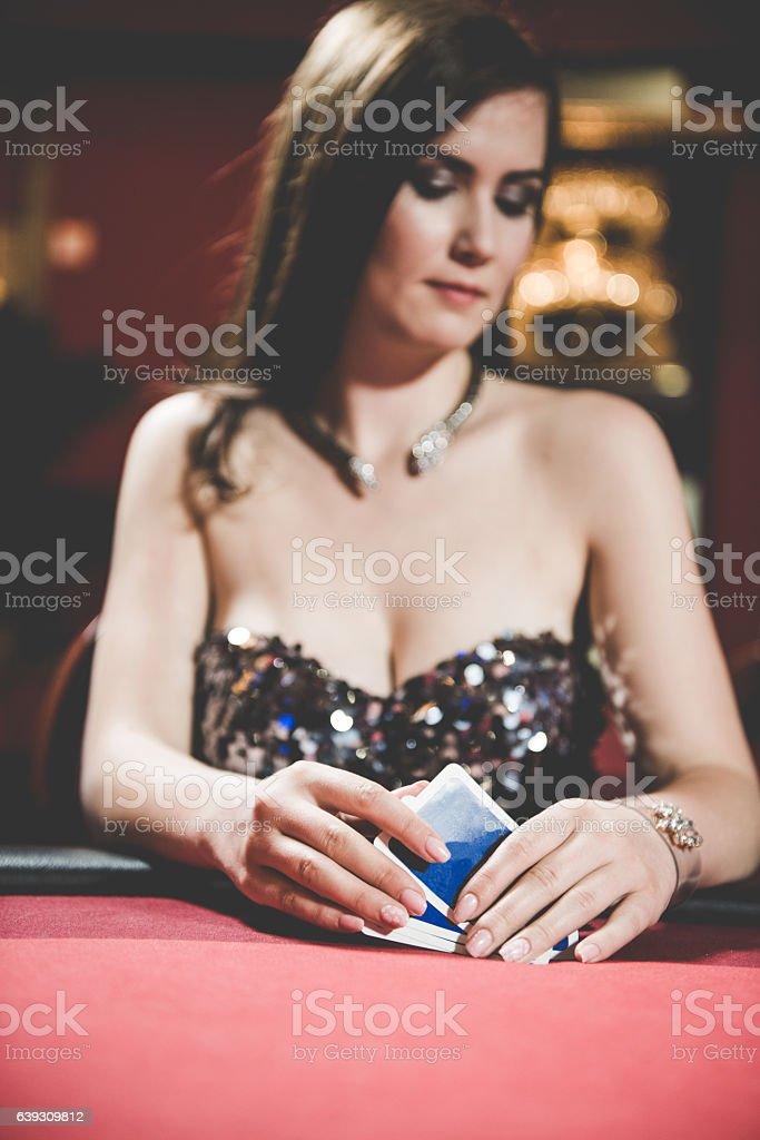 Beautiful Woman Playing Poker at the Casino, Europe stock photo