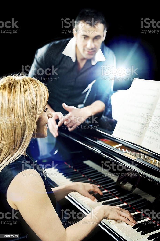 Beautiful woman playing the piano. royalty-free stock photo