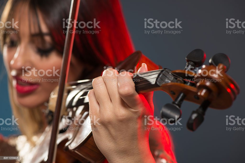 Beautiful Woman Playing The Violin stock photo