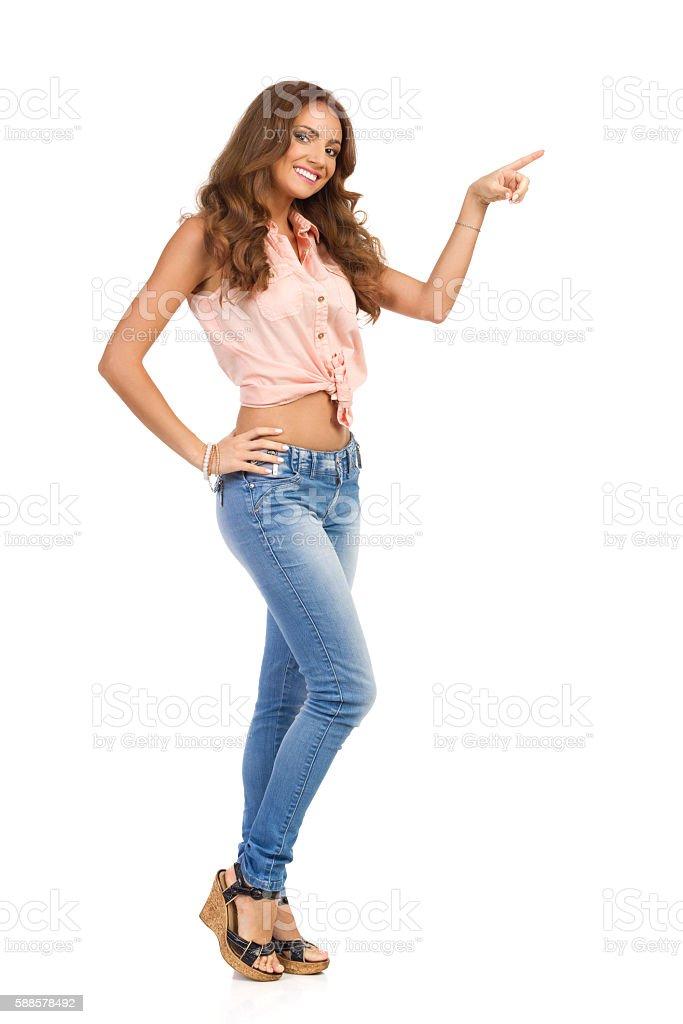Beautiful Woman Pointing Full Length stock photo