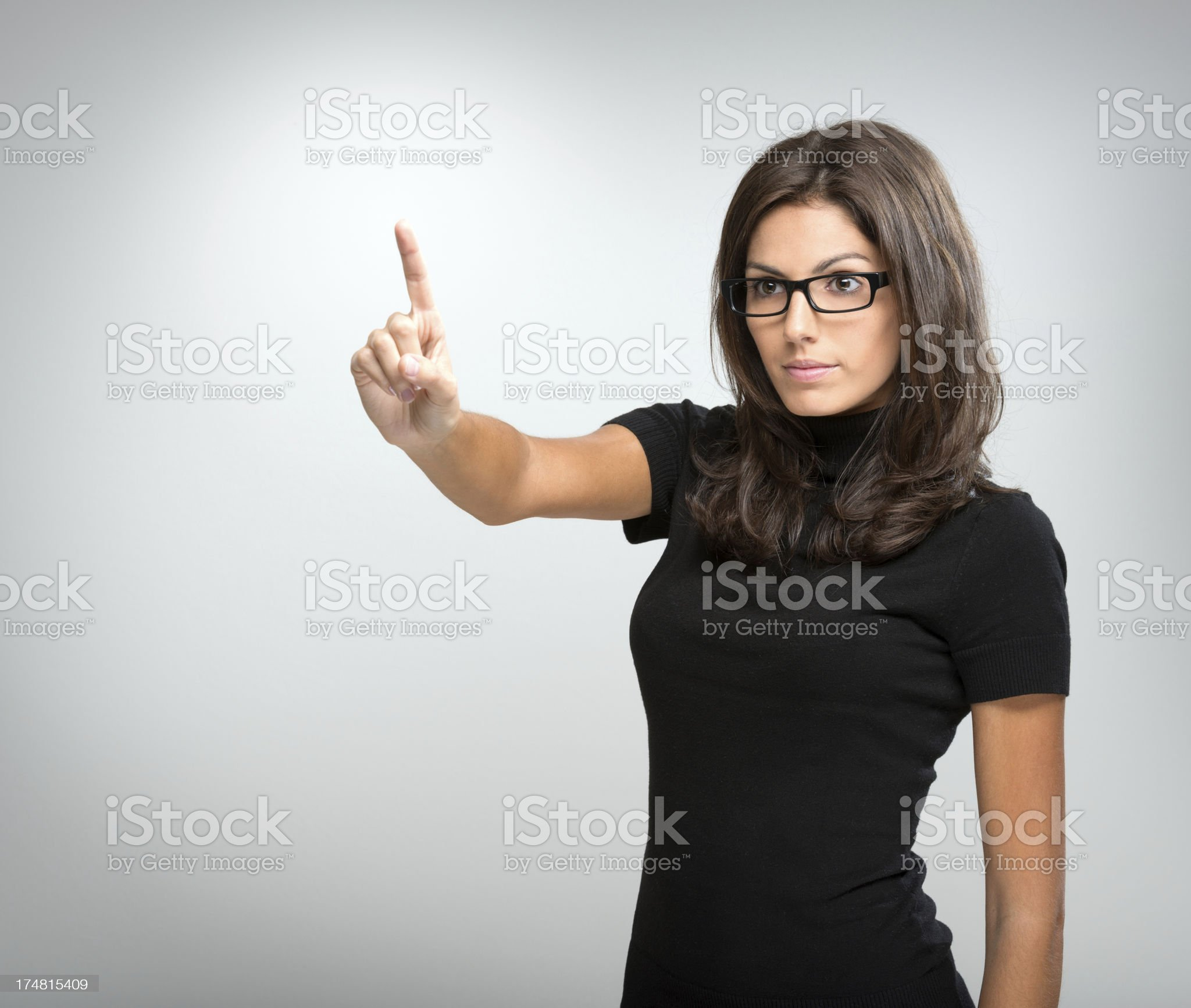 Beautiful Woman pointing into virtual Copy Space royalty-free stock photo