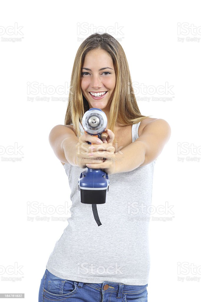 Beautiful woman pointing to camera with a power drill royalty-free stock photo