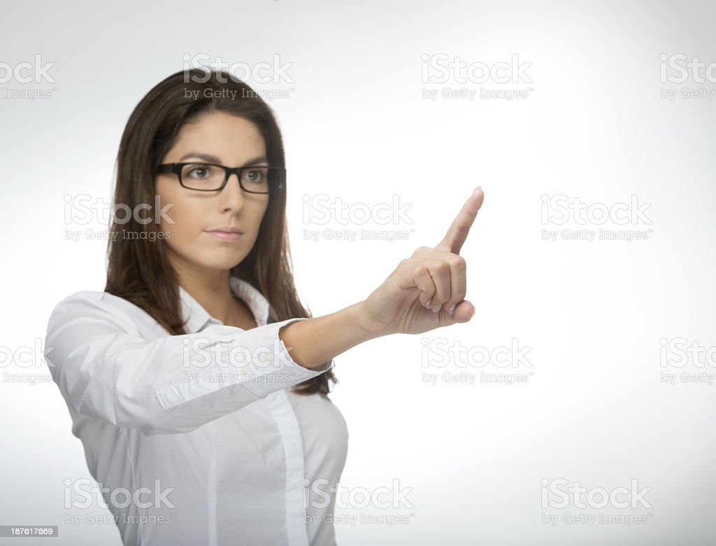 Beautiful Woman pointing to Copy Space royalty-free stock photo