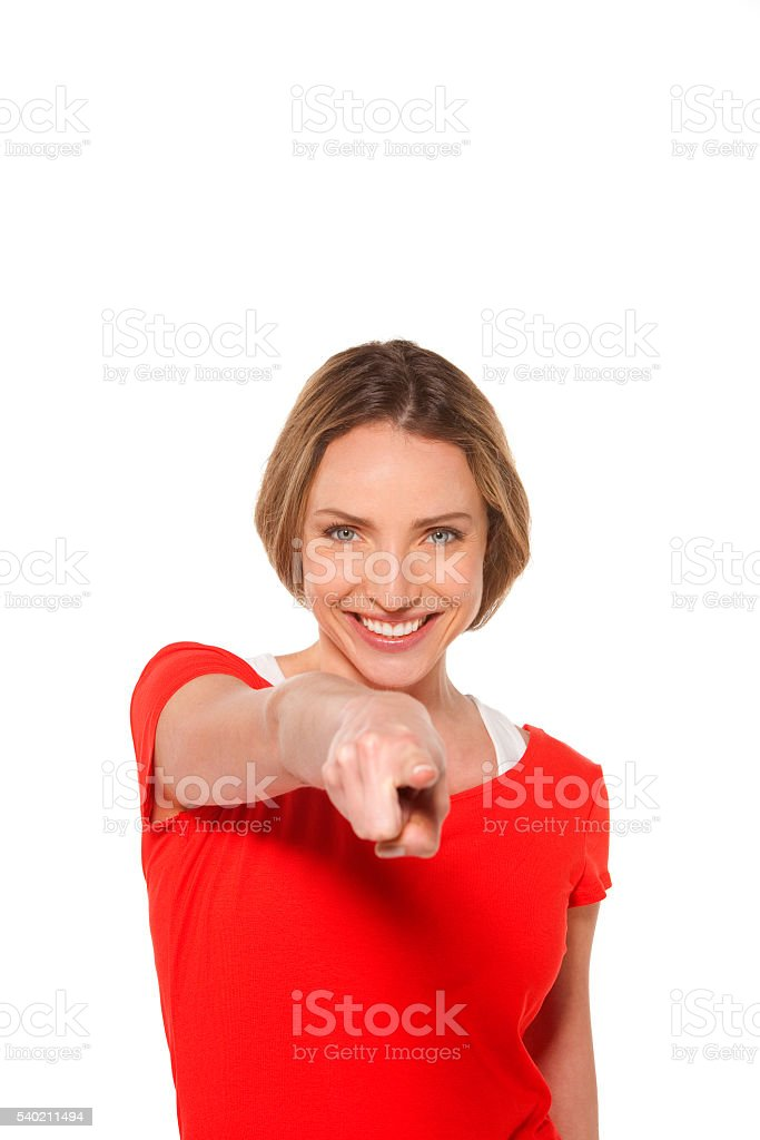 Beautiful woman pointing to the camera stock photo