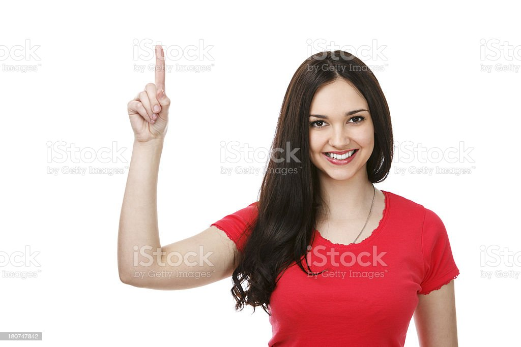 Beautiful woman pointing up at copyspace royalty-free stock photo