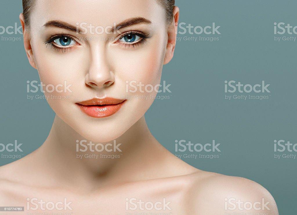 Beautiful woman portrait face close up studio gray background stock photo