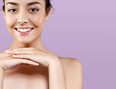 Beautiful woman portrait healthy skin perfect makeup. Pink background.