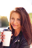 Beautiful woman portrait holding a cup of coffee