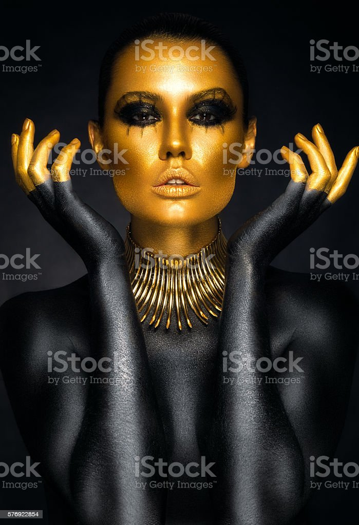 Beautiful woman portrait in gold and black colors stock photo