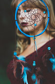 Beautiful woman portrait through dream catcher