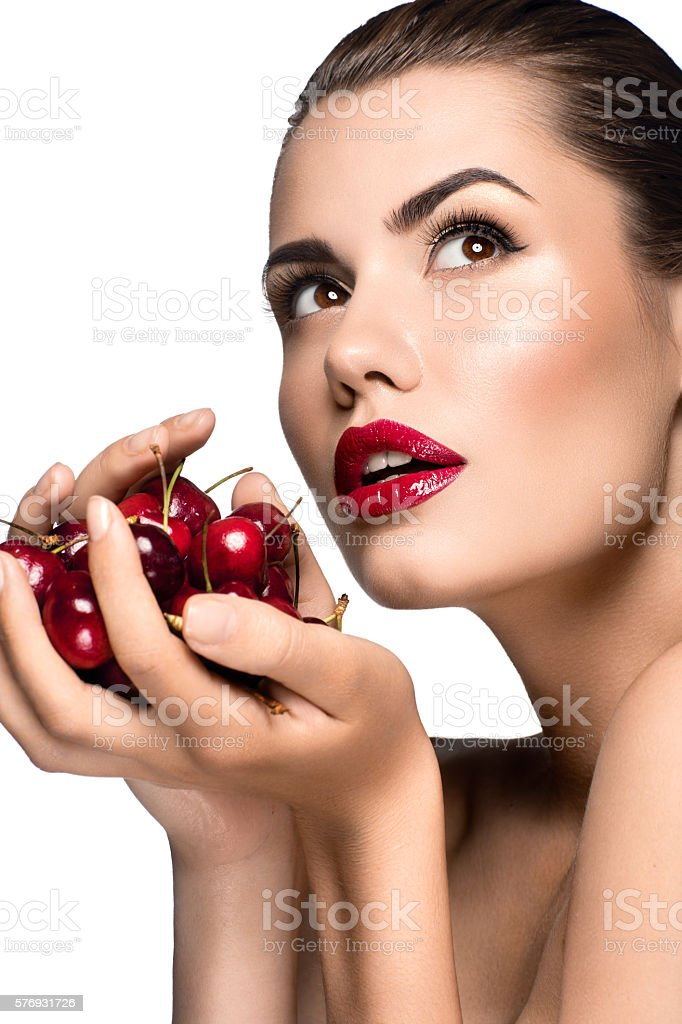 Beautiful woman portrait with cherry stock photo